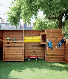 If tidiness is paramount for the family, a place for the kids to play outdoors is equally important. The climbing wall at the back of the garden is entirely the work of Mark Tiarks, who built the Composite House and who relished a chance to step out from beneath Tozer's plans and design an aspect of the house himself.  Photo by Matthew Williams.