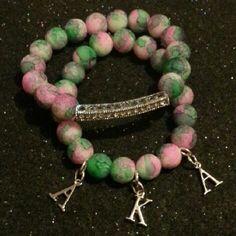 AKA pink and green beaded bracelets