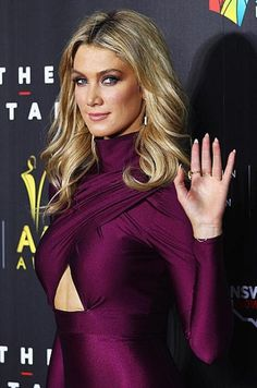 Goodrem stepped out at the AACTA Awards in Sydney last month coordinating dusky burgundy eyeshadow with her skintight dress