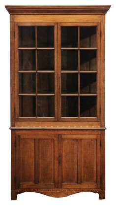 South Carolina Federal Inlaid Walnut Corner Cupboard  attributed to Greenville/Spartanburg area, early 19th century, two-case construction with poplar secondary, geometric inlays, upper case with two eight-pane glazed doors and fixed-shelf interior, lower case with two double-panel doors on a shaped and inlaid skirt, 86 x 46-1/4 x 22 in.