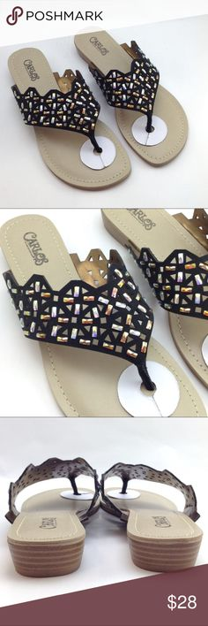 """Carlos Santana black jeweled sandals Faux leather uppers. Laser cut design w/ jeweled accents. 1"""" heel. Pics also show how they are packaged and insole measurement. Carlos Santana Shoes Sandals"""