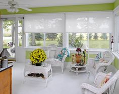 White and bright solar roller shades in sunroom!