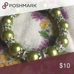 Simulated Green Pearl Rhinestone Bracelet The beads are strung on stretch cord. Jewelry Bracelets