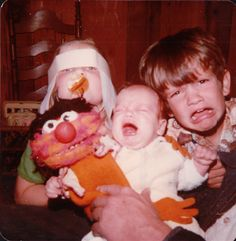 """With my first camera, I posed my sister and brothers for a picture with my Animal puppet. Right before I snapped the picture, my sister (with her upside Easter bunny ears) took the baby's pacifier. My brother then made a face mocking the baby's pain."" (submitted by David)"