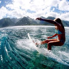 Take in that view, the colours, the crystal clear water AND that surf!