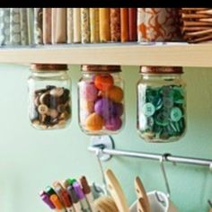 I had seen this long ago and forgotten.  Screw the lids directly to bottom of shelf above, then screw jar to lid - Tah Dah! ATTACHED and hanging - out of the way and looks beautiful. I may do some in my kitchen cupboards :) - Granola, cookies, crackers....