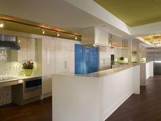 This universally accessible kitchen design features spacious double islands #MagreetCevasco #VasiYpsilantis