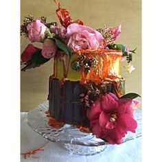 Toffee arches of fresh flowers over a beautiful creamy vanilla bean butter cake.