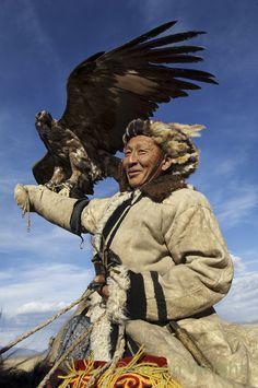 Kazakh hunter and his eagle. Olgii, western Mongolia