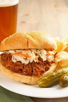 Oven-Roasted Pulled Pork Sandwiches: This pork is coated in a dry rub, roasted in a slow oven until meltingly tender, mixed with barbecue sauce and served in soft rolls topped with coleslaw - decadent and delicious.