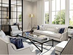 Elegant living room decor. Luxury living room with white dofas and blue pillows.