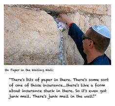 Karl places paper in the Wailing Wall