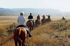 Location: Greenough, Montana Though you might be coming for the horseback riding, this 37,000-acre Montana ranch also offers hot-air ballooning, go-karting, ATV tours, and fly-fishing, just to name a few of the on-site activities available. But the best part of your visit may just be the resort's amazing luxury camping accommodations. For more information, visit The Resort at Paws Up.   - CountryLiving.com