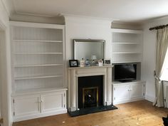 Pair of fitted alcove units we made . Great use of space and I think they complement the rooms original period features..