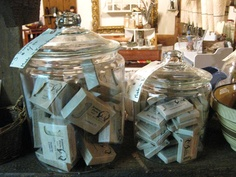 oversize glass jars organize and display - lids are easy to attach price tags to