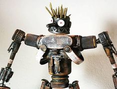 Check out this item in my Etsy shop https://www.etsy.com/listing/571055976/assemblage-valerobots-rusted-droid