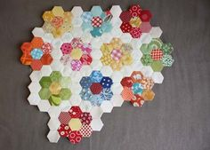 Fabric scraps - use English paper piecing method and mini hexagons to quilt flowers