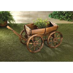 Old Country Wood Barrel Wagon Planter - Make your yard bloom with rustic charm as the green leaves of your favorite potted plants or herbs peek out from this outdoor Old Country Wood Barrel Wagon Planter. This wagon is made from half of a wooden apple barrel, and the wooden wagon wheels that are expertly crafted.