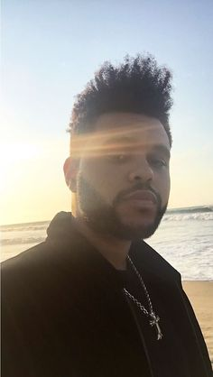 Just walking on the beach and hey, hi Abel. Then walk on and give the man some peace. #XO #weeknd