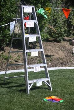 Bean Bag Ladder Toss  Label each rung of a step ladder with points and let the kids try to get as many points as possible by throwing bean bags between the rungs.