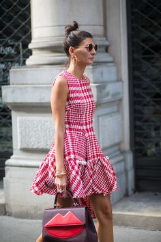 Giovanna Battaglia in a Simone Rocha dress, Dita sunglasses, and with a Sara Battaglia bag.