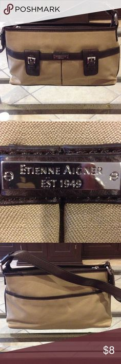 Etienne Aigner brown/tan purse good condition Etienne Aigner brown/tan purse good condition zipped section with two pouches and zipper pouch inside Etienne Aigner Bags