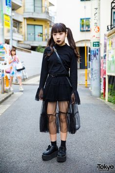 Bemi's all black fashion style features a vintage sweater with extra long sleeves and sheer cuff, a black sheer skirt from Nadia Harajuku, black socks, vintage platform creepers, and a vintage leather sling bag. Her only accessory is a black leather belt.