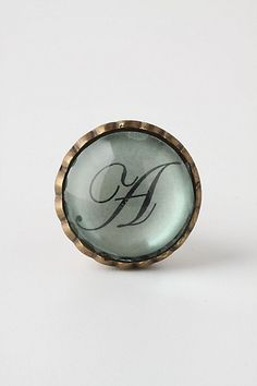 Monogrammed Anthro knobs.  I'm stealing a Pinterest idea and using these to personalize our night stands.
