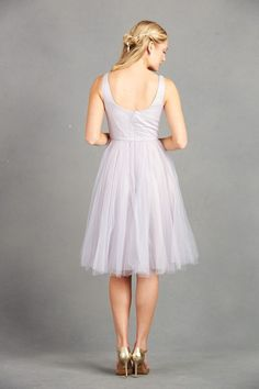 Flirty Tulle Bridesmaid Dress: This flirty gown with tulle skirt will have your best girls feeling fun and fashionable. It's also easy to move around in, allowing them to be the life of the party on the dance floor! Paired with metallic gold heels, this is perfect for a modern wedding.