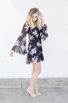 A moody floral graces the irresistibly flirty silhouette of this chiffon tie-back dress. The keyhole back and flowing sleeves make it a dream to wear. Lined skirt and bodice.   100% polyester. Hand wash cold, dry flat.
