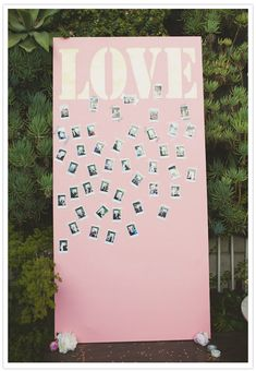 A giant painted canvas, patterned washi tape, and an Instax Mini Instant Camera for guests to snap cute pics of each other and tape them up with little messages.