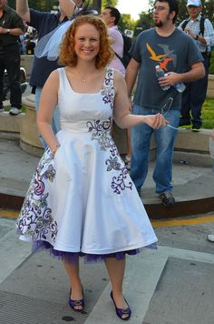 Funky tea length wedding dress in silk, with colorful faux-embroidery, pockets, and purple petticoat, by VictoriaVM.