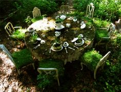 I think that this is so neat. I might add one to the corner of my yard. moss covered table. makes me think of Alice in Wonderland