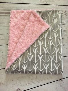 A personal favorite from my Etsy shop https://www.etsy.com/listing/513749478/personalized-baby-blanketgray-arrow