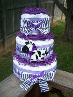 Hey, I found this really awesome Etsy listing at http://www.etsy.com/listing/102587061/adorable-diaper-cake-baby-girl-purple