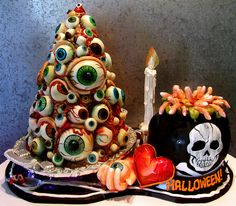 Halloween eyeball cake. (No tutorial but I would make it by layering and carving the cake into a cone then using large cake pop eyes, frosting blood and modeling chocolate for brows.)