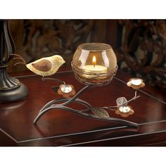 Crafty candleholder blends nature's beauty and modern art for a truly unique decoration! Warm earth tones lend a sophisticated air to this stylized bird's nest with bronze candle cup