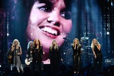 An all-star group gathered on Thursday night to pay tribute to the ailing Linda Ronstadt, whose battle with Parkinson's disease kept the singing legend from her own Rock and Roll Hall of Fame induction. Stevie Nicks of Fleetwood Mac, Sheryl Crow, Emmylou Harris, Bonnie Raitt and Carrie Underwood performed in her place, helping to frame the legacy of a now-67-year-old star who had already won Grammy, Emmy, Golden Globe and Tony awards over a career that's spanned more than 30 albums.