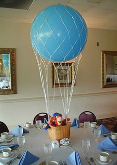 Love the idea of the balloons in netting to keep them as a for Balloon nets for centerpieces