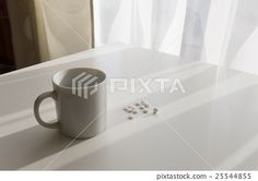white pills lying next to a glass of water
