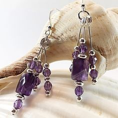 Be still, my beating heart! Amethyst and sterling silver earrings in a trio of beautifully faceted dangles. Plenty of sparkle and shine to light up your face and capture your heart! Only one pair available. Amethyst Bracelet, Amethyst Jewelry, Amethyst Earrings, Gemstone Jewelry, Dangle Earrings, Unique Jewelry, Statement Earrings, Fringe Earrings, Sterling Silver Bracelets