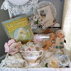 Wonderful vintage pieces and so lovely with the lace and linens.