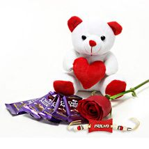 Gift hamper of Cute Teddy Bear, Single Red Rose stem, 5 Cadbury Dairy Milk Chocolate and friendship band.