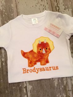 A personal favorite from my Etsy shop https://www.etsy.com/listing/199610029/dino-two-a-saurus-appliqued-shirt-white