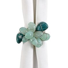 Ten authentic agate stones are clustered onto our unique Sea Mist Rocks napkin ring. $27.80 for a set