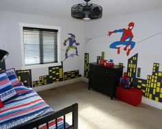 Bedroom Design, Cool Modern Baby Boy Bedroom With Spiderman Vs Green Goblin Themed Also Black Bureau Also Red Toy Case Also Black Ceiling Fan And Windows With Black Blinds Also Single Bed With Spiderman Theme Color: Superhero Baby Boy Bedroom Ideas