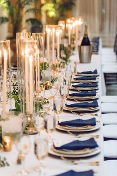 Navy blue napkins on gold chargers taper candles in glass cylinders Amalfi Coast Inspired Wedding at The Pennsylvanian from Bumbleburgh Events Leeann Marie Photography featured on Burgh Brides Find more wedding inspiration at Navy Blue And Gold Wedding, Gold Wedding Colors, Gold Wedding Theme, Wedding Ideas Blue, Navy Wedding Flowers, Navy Gold, Wedding Bouquet, Wedding Dresses, Blue Wedding Decorations