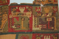 Textile fragment; ground cloth of cotton plain warp-faced weave(?); stepped tapestry section: camelid wefts; five profile heads on coloured square backgrounds, each with L-shaped tear appendages, patterned headbands and headdresses, bird head and feather(?)motifs, staff-like object in front of faces with three-pronged 'feather' motifs on top; two rectangles with geometric motifs.  Tan cotton with red, indigo, green, tan and white camelid fibre.