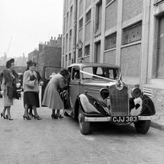 A unknown family wedding at Hackney in London's East End - 1940's. Note the blackout headlights on the car.