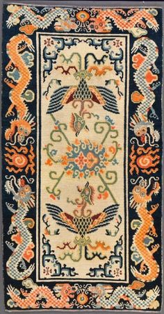 TIBETIAN PHENIOUX CARPETS | Phoenix and Dragon Carpet; Tibet; early 20th century; wool warp and ...